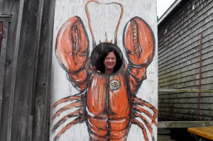 Your hostess has eaten so much lobster on this trip, she's turned into one. But she doesn't seem to mind.